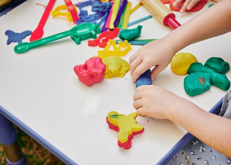 Children moulding playdough as part of STEM education