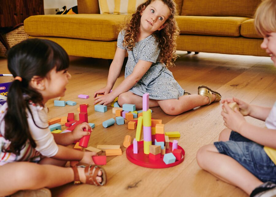 Preschoolers playing with wooden building blocks as a STEM activity