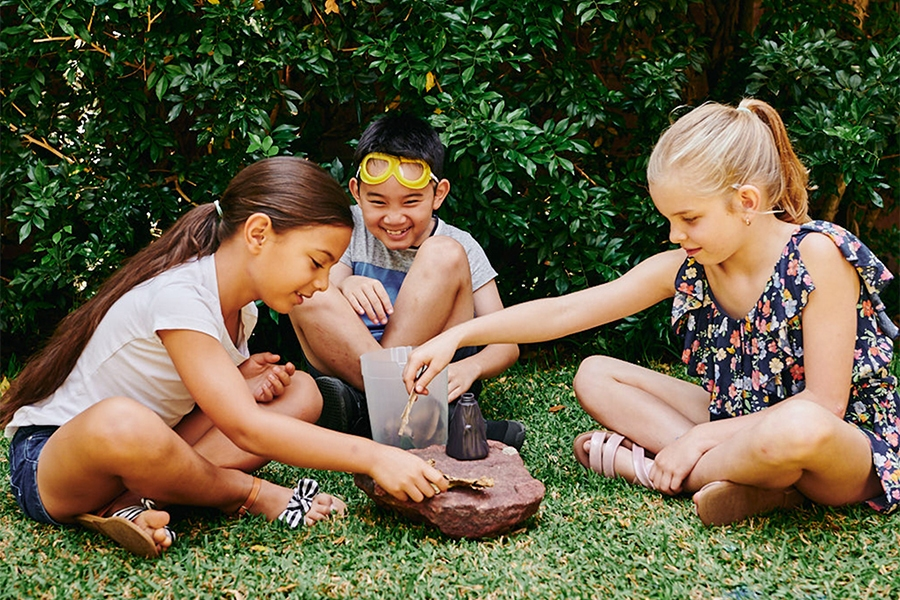 Young children playing with volcano STEM learning activity