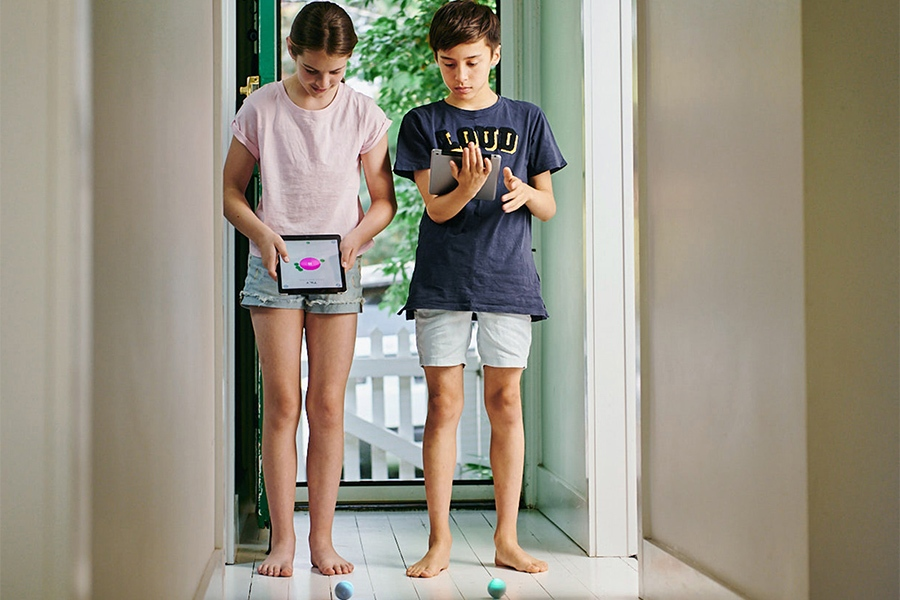 Tweens using iPad to code robotics kit STEM toy