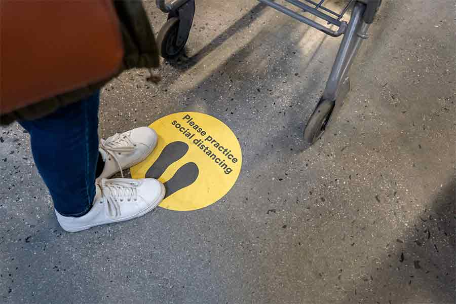 Floor decals promoting social distancing will help businesses adhere to health and safety regulations.
