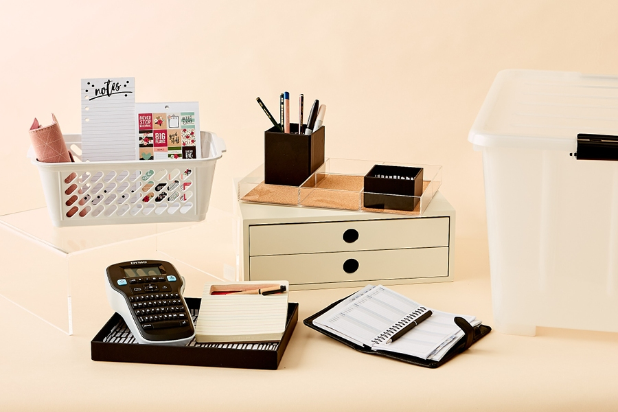 Keep your small home office desk clutter-free with baskets and drawers.