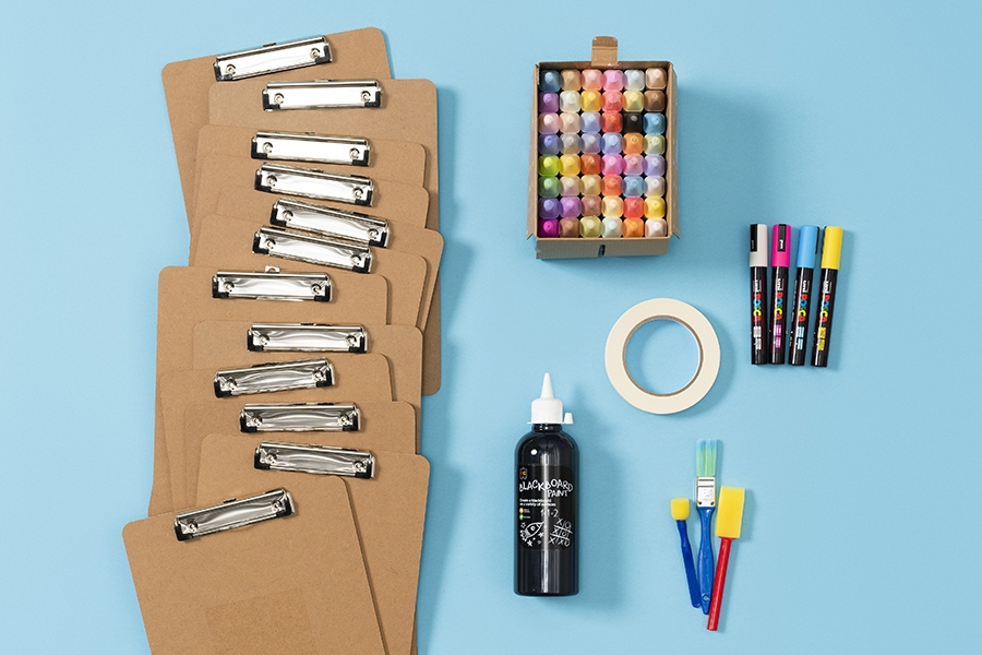 Craft supplies for a DIY clipboard calendar project using chalkboard paint
