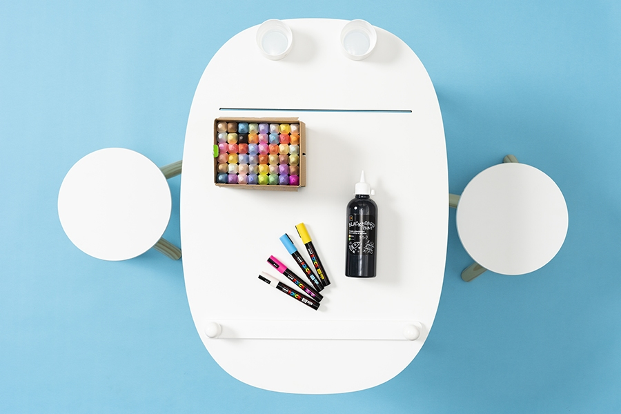 Paint and craft supplies you need for a DIY kids furniture chalkboard project.
