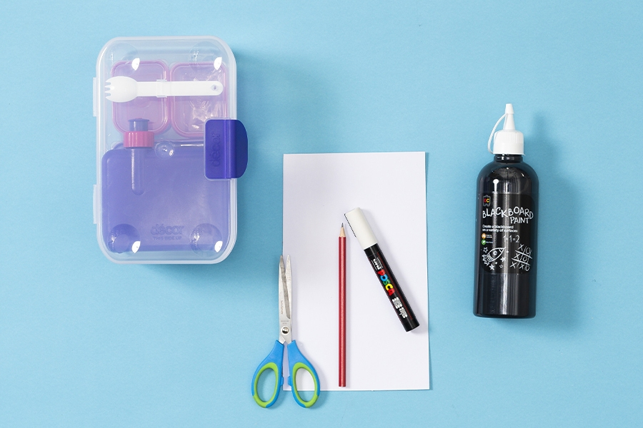 Craft supplies you need for a DIY chalkboard paint message board for kids
