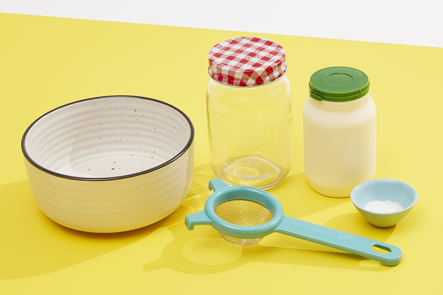This kids science experiment for making butter teaches concepts about chemistry.