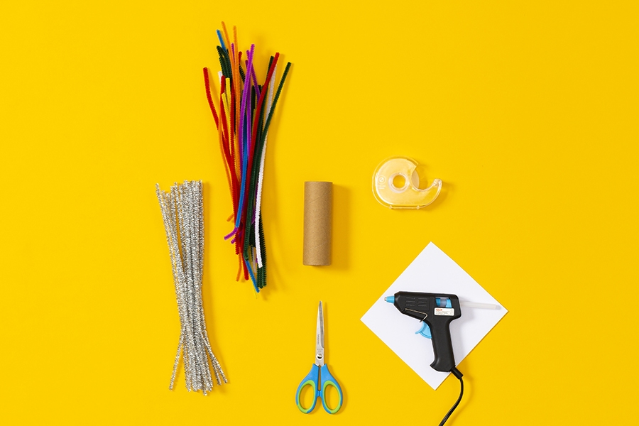 Craft supplies you need for a kids DIY project to make flowers using pipe cleaners.