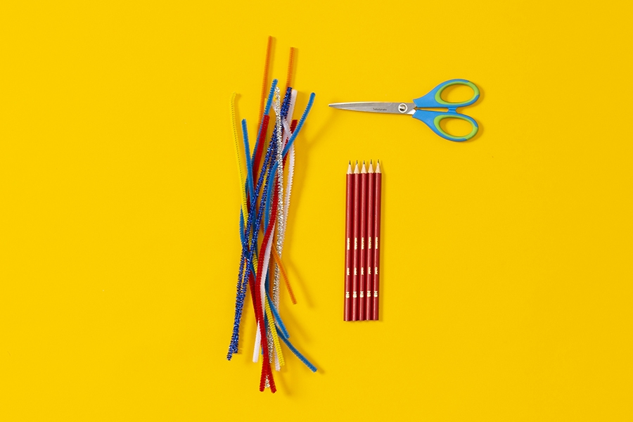 Craft supplies kids can use to decorate pencils with pipe cleaners as a fun DIY project.