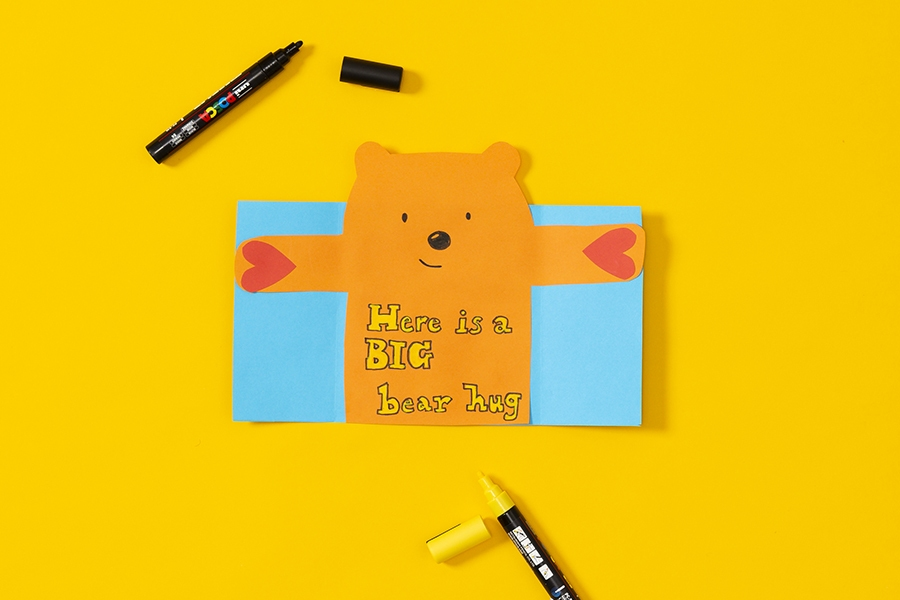 Father's Day card idea for kids to make an easy bear hug card as a craft project.
