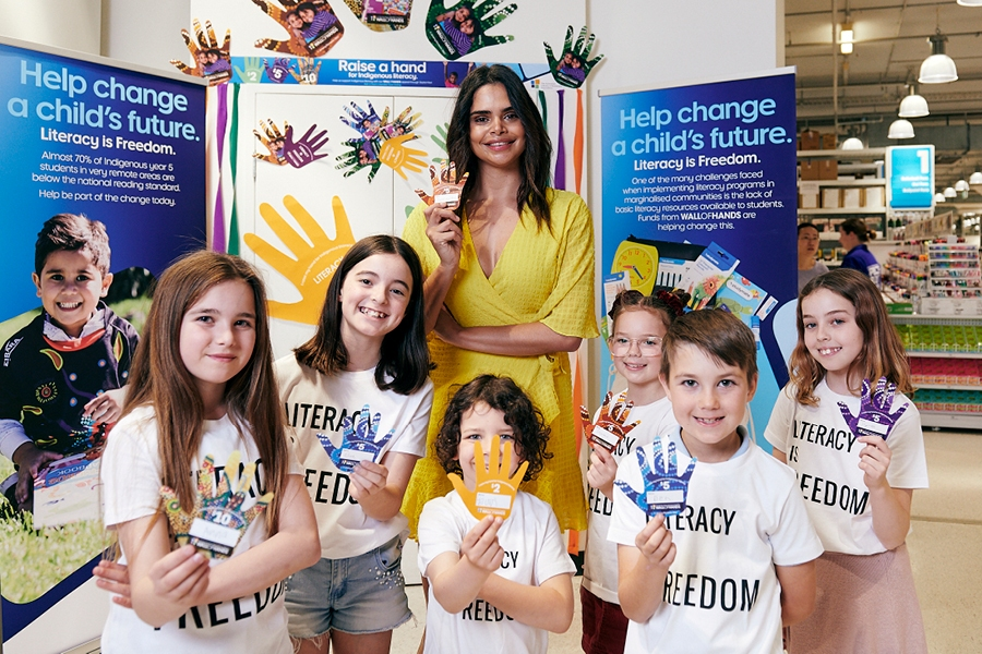 Australian model Samantha Harris supports Officework's Wall of Hands in 2019