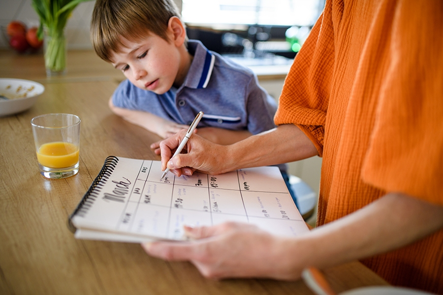 Involve your kids in drawing up your routine chart so they're more likely to follow it.