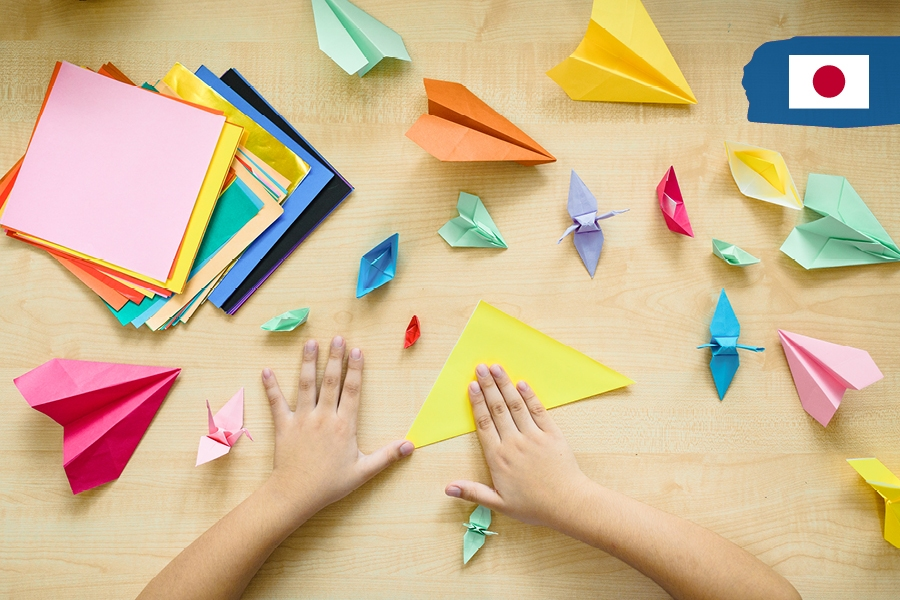 Kids can travel the world from home to Japan with origami as an activity.