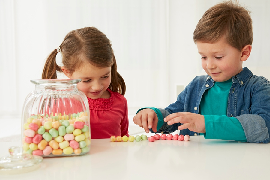 Kids can learn the times table at home by counting out objects in patterns and grids