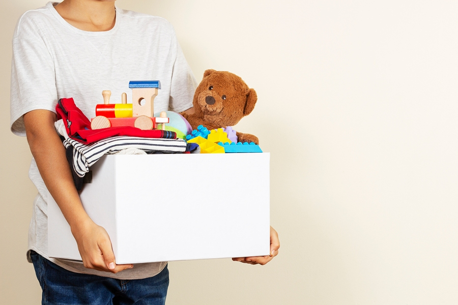 Donating used books, toys and clothes is a great way to show kids how they can make a difference