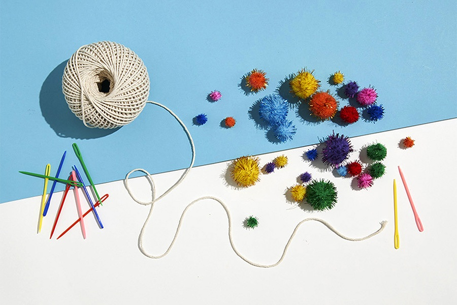 Art project supplies for kids: twine and pom poms
